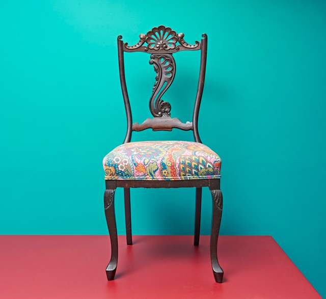 Reupholstered ornate chair