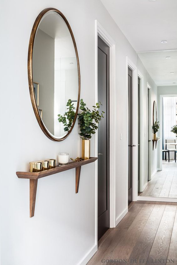 Round mirror and shelf hallway decor