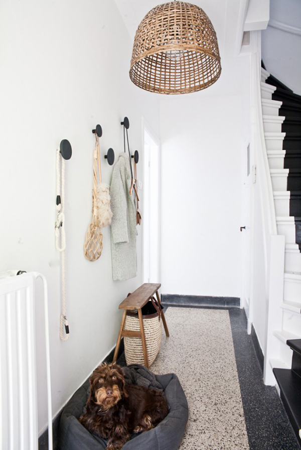 Wicker lamp and dog bed in white painted entryway