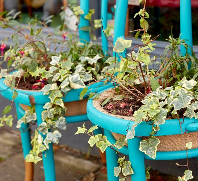 chairs repurposed as planters