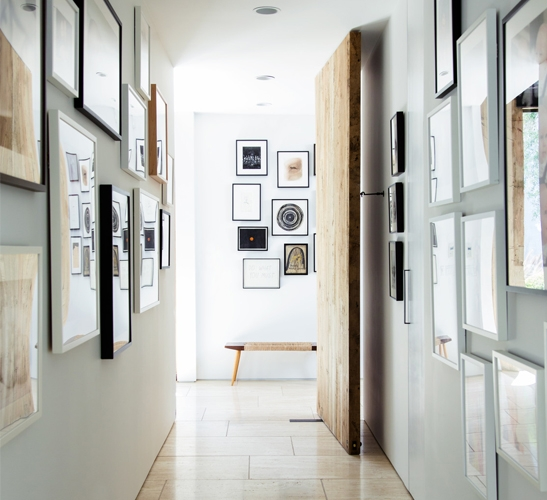 narrow corridor decorated with frames