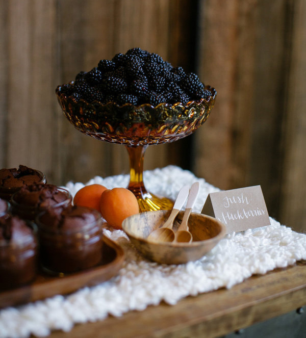 Orange glass bowl filled with blackberries
