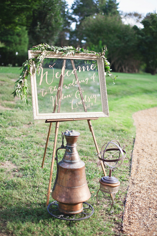 Wedding signage on framed glass