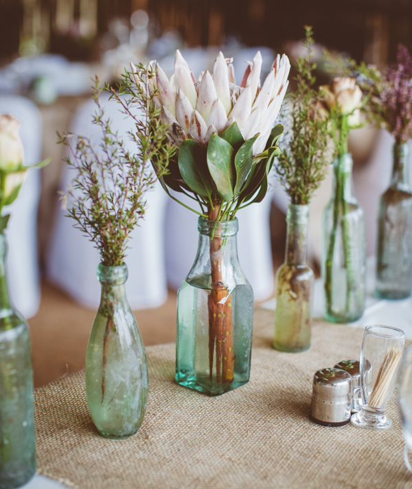 bottles as vases for wedding table