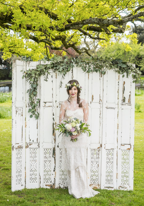 bride standing in front of vintage doors