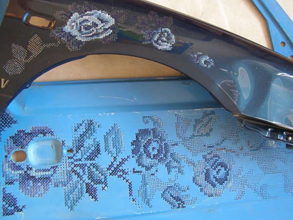 car doors embroidered with cross stitched floral design