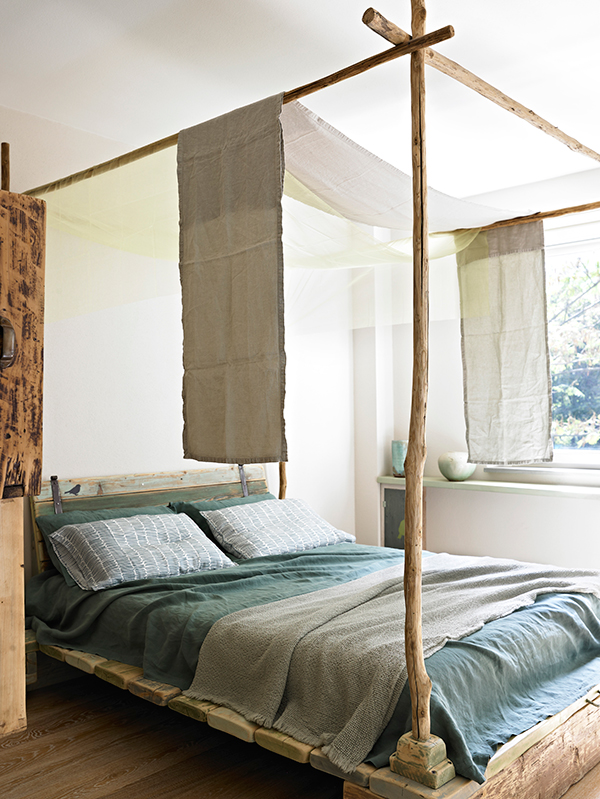Four poster bed made from locally sourced wood at Eco B&B Il Richiamo del Bosco