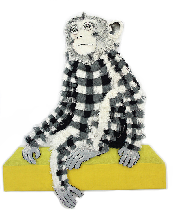 Textile monkey sitting by Karen Nicol