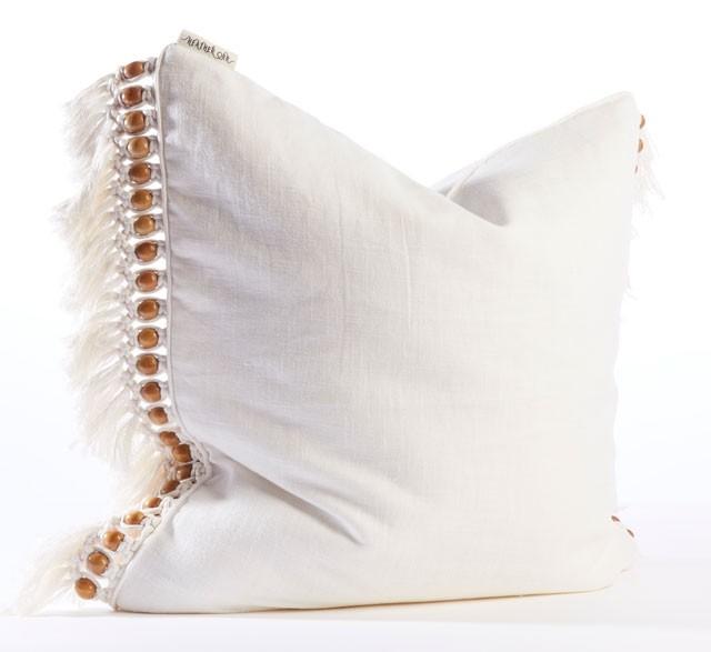 White fringed beaded cushion