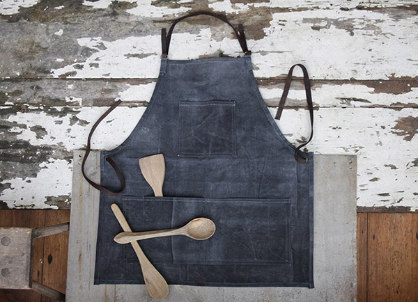 Artisan kitchen apron made from recycled tents by Nkuku