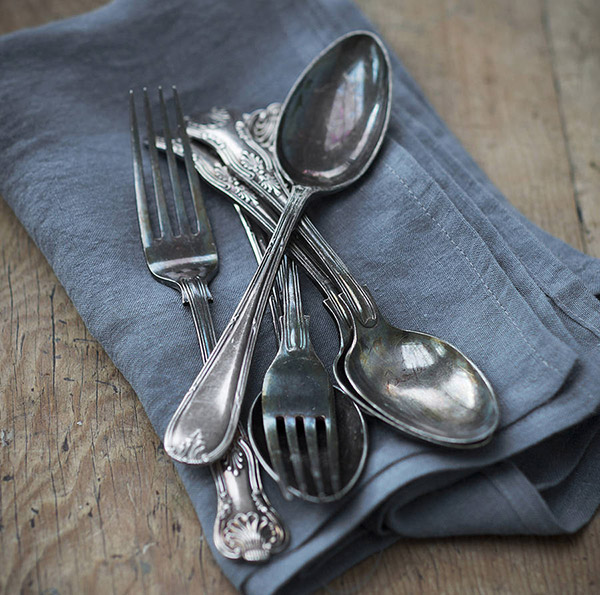 Natural linen napkins by The Linen Works with vintage cutlery