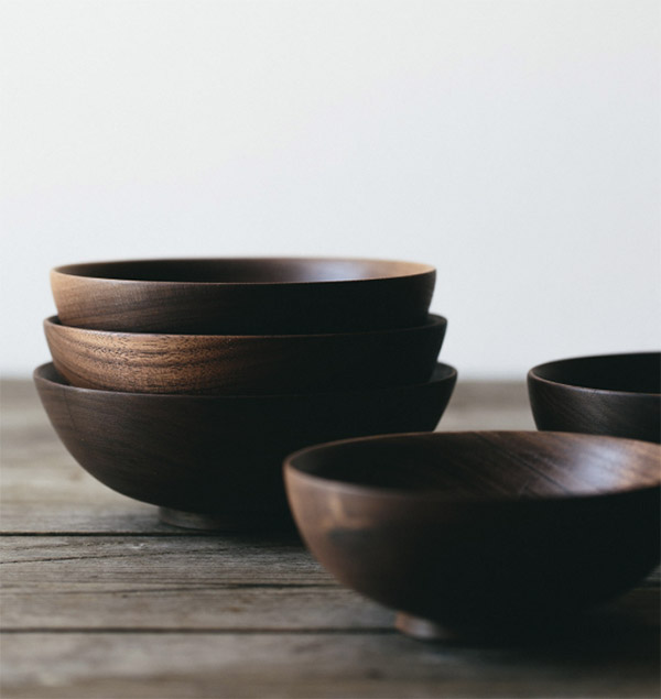 Stack of round bowls made from reclaimed walnut