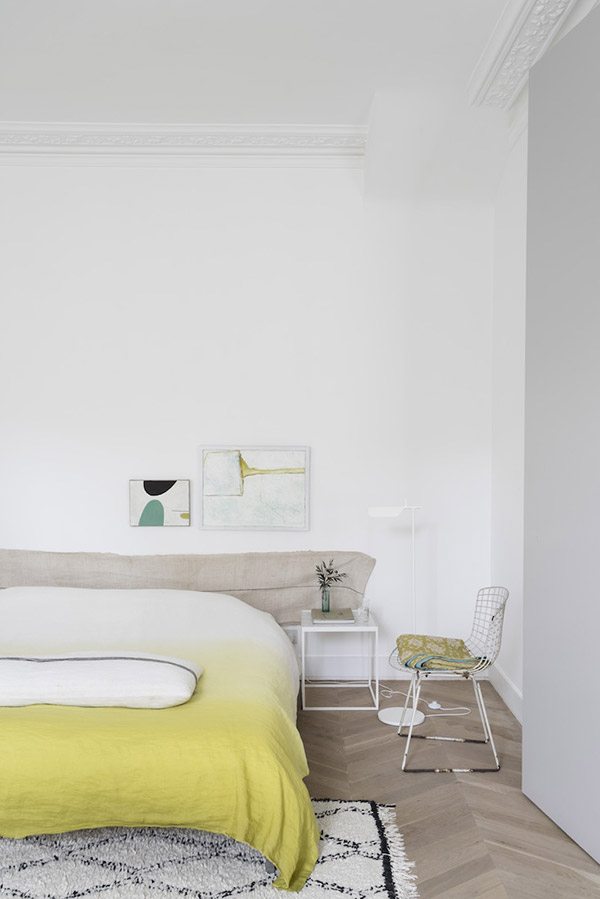 Bedroom painted white with yellow accents