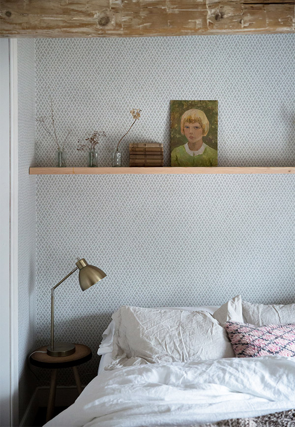 Bedroom shelf styled with vintage finds