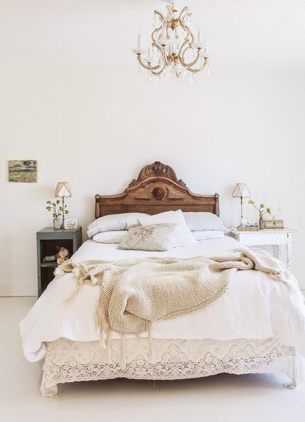 Carved dark wood headboard in a white bedroom