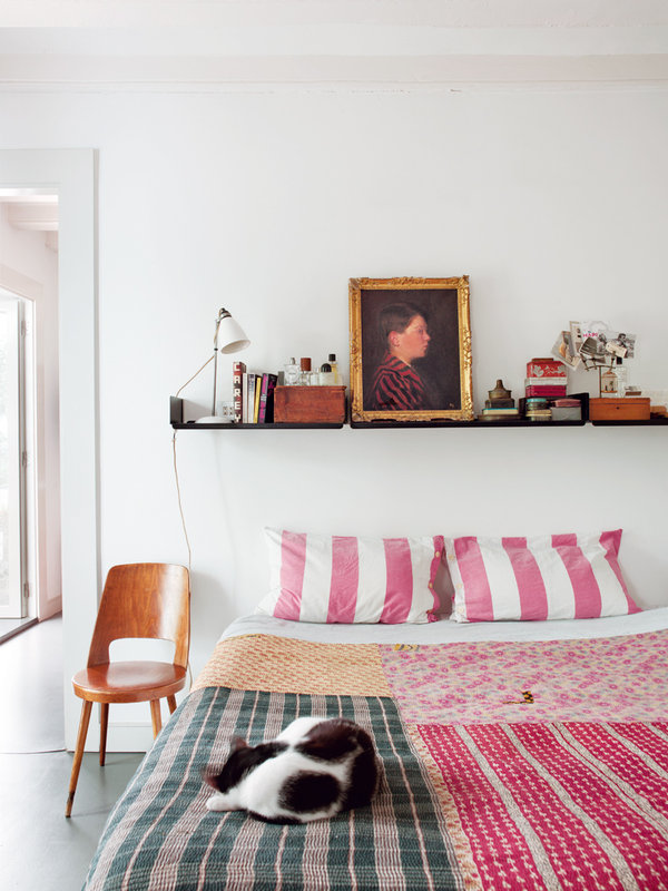 Eclectic vintage furnishings in the bedroom