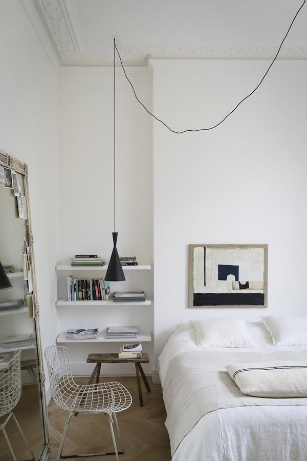 Hanging beside lamp in modern bedroom
