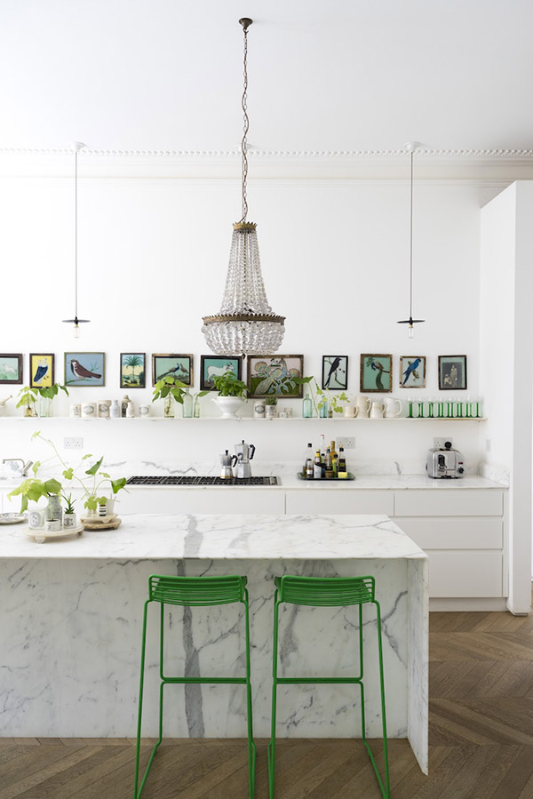 Marble kitchen island with chandelier pendant light in a Victorian house renovation