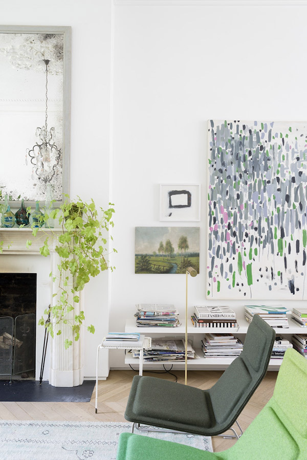 Modern living room interior with green accents