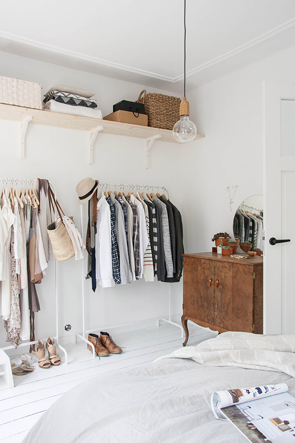 Scandi ideas for decorating the bedroom with open closet and vintage dresser