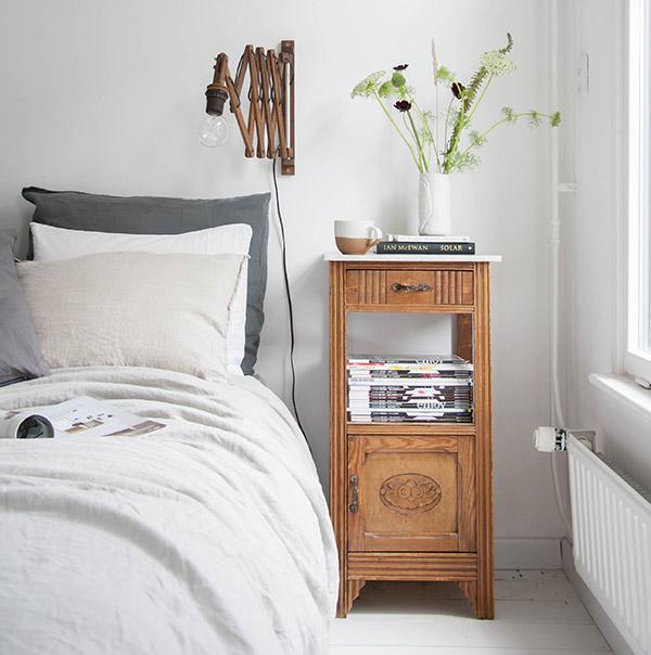 Vintage bedside table in a modern bedroom