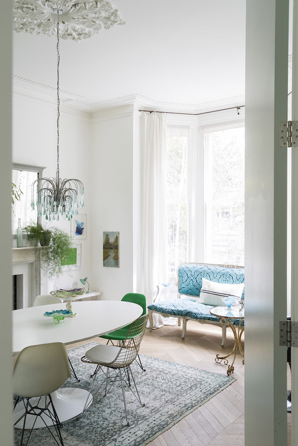 White dinning room with blue and green accents