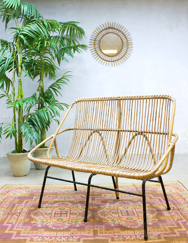 Vintage rattan lounge sofa in a bohemian interior