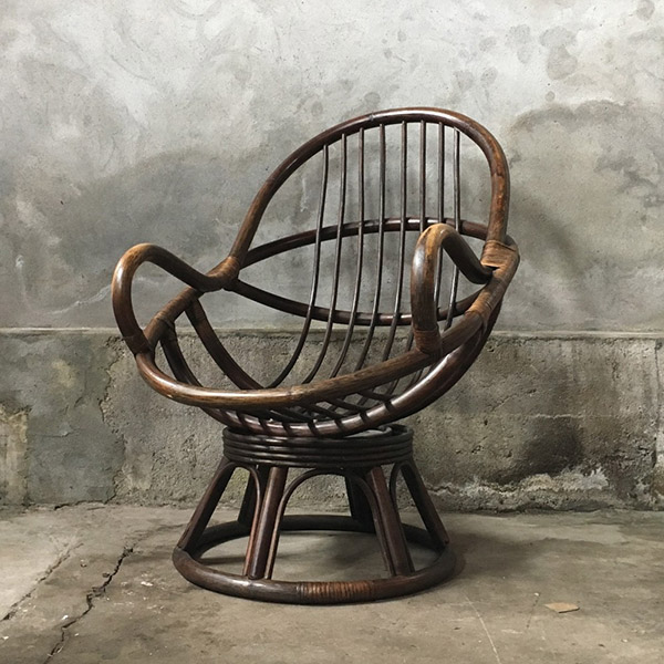 Vintage rattan swivel chair for the bohemian interior