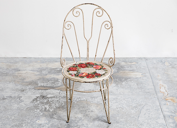 Antique chair embellished with mosaic design