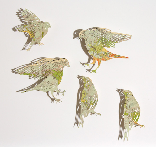 Birds cut out of maps by Claire Brewster