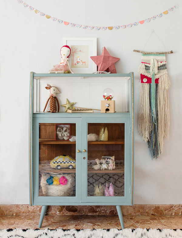 Blue vintage cabinet in a kids bedroom