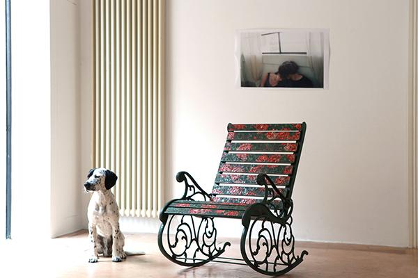 Dog sitting next to a reworked rocking chair by Yukiko Nagai