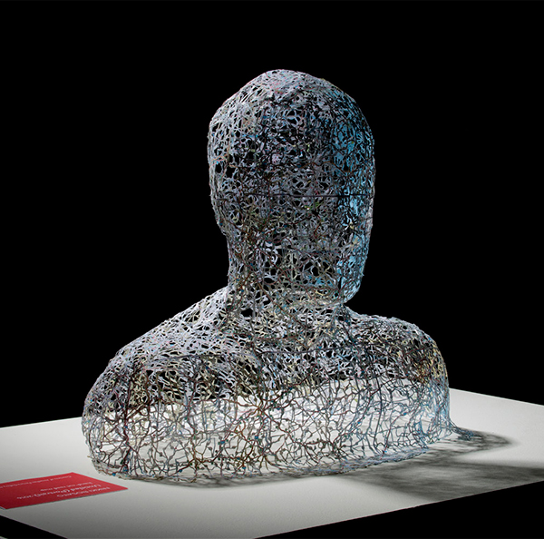 Human bust made from cut out road maps by Nikki Rosato