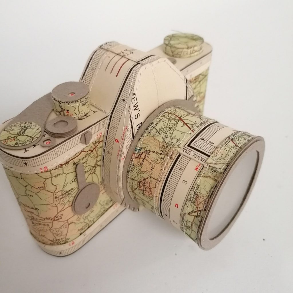 camera handcrafted from old maps by paper artist Jennifer Collier