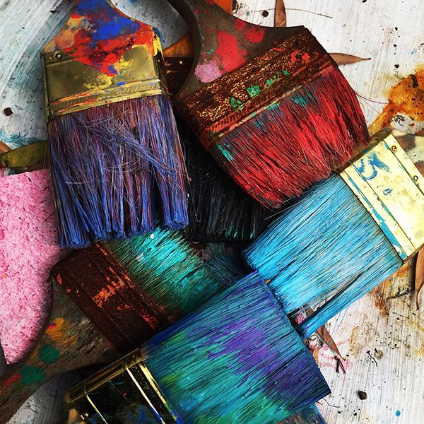 Colourful used paintbrushes