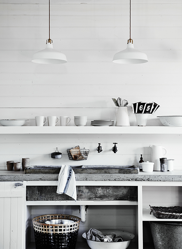 Concrete worktops in the kitchen with modern rustic interior decor