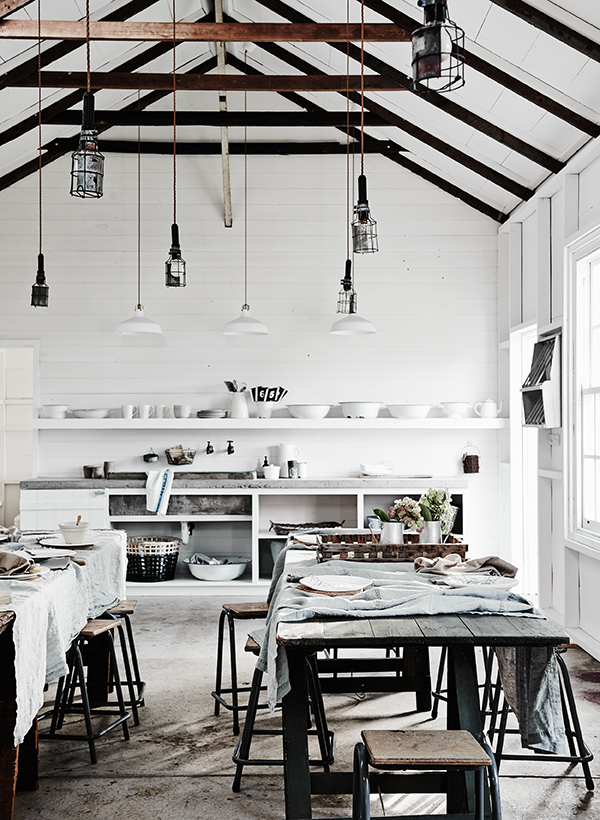 Contemporary barn interior with vintage light fittings