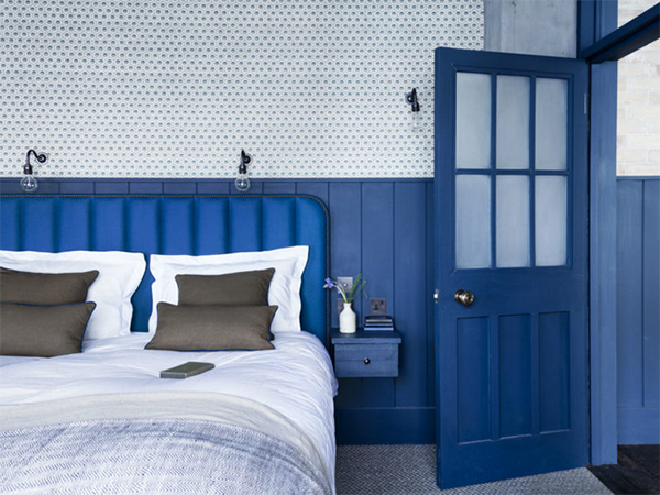 Dark blue painted bedroom