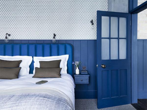 Dark blue painted bedroom