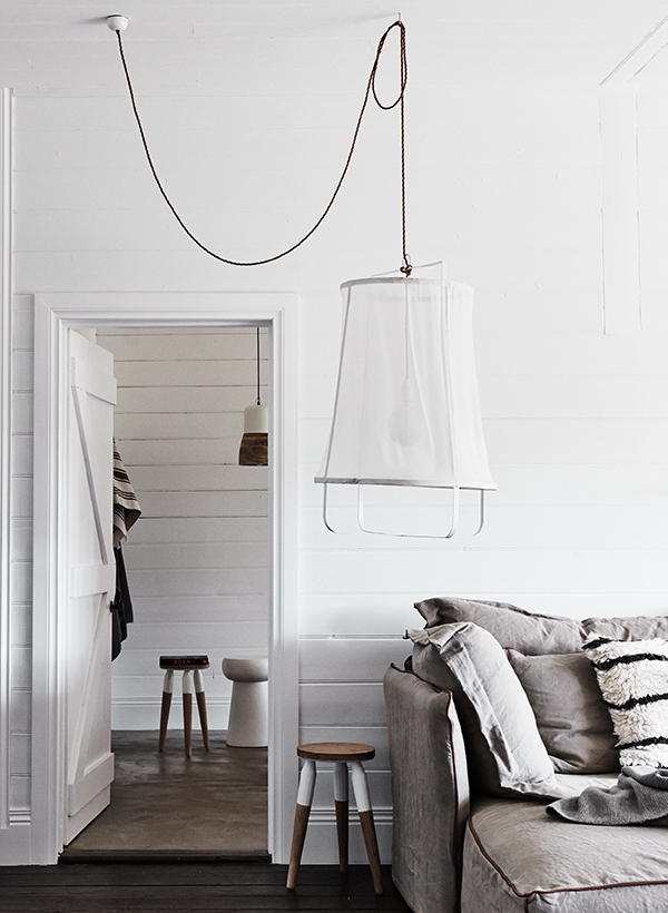Fishing net lampshade in white modern interior