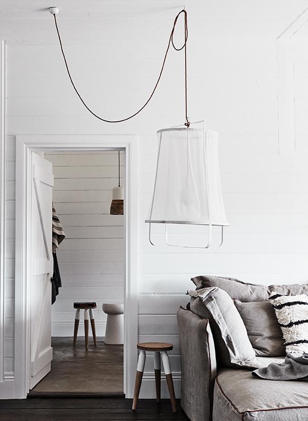 Fishing net lampshade in white modern interior