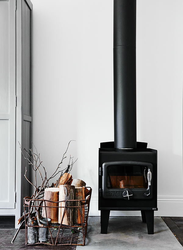 Modern rustic stove and firewood