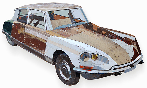 Bas relief car sculpture made from scrap wood by Ron van der Ende