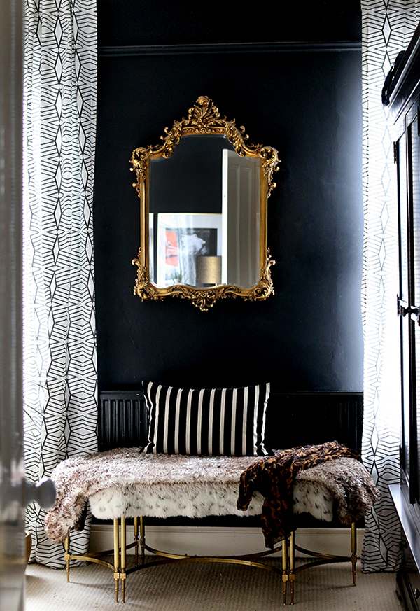 Black painted walls in the bedroom by Swoonworthy