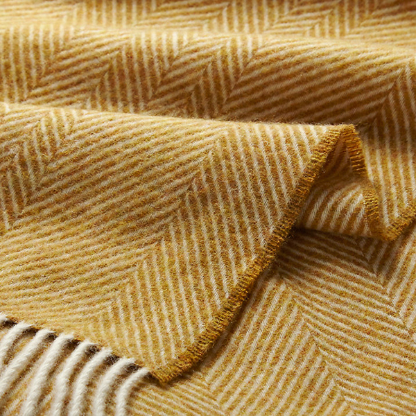 Bronte by Moon herringbone wool throw in honey