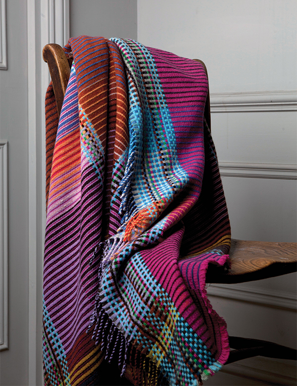 Colourful blanket for a hygge inspired home by Wallace & Sewell