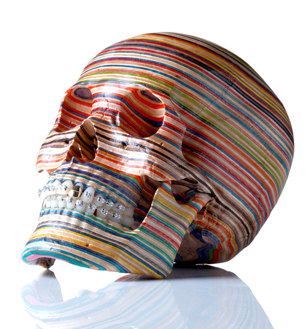 Skull sculpture made from scrap skate board decks by Haroshi