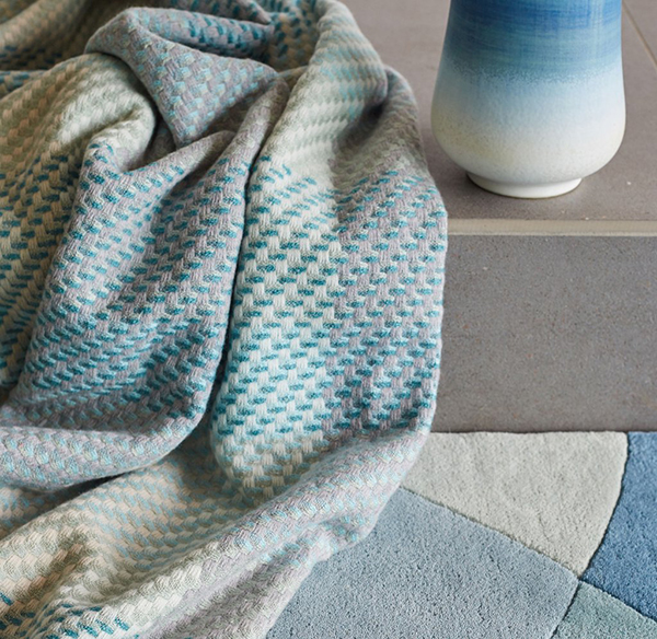 Turquoise blue throw by Claire Gaudion
