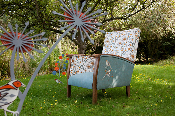 Armchair reupholstered in floral and bird print fabric Polly Granville