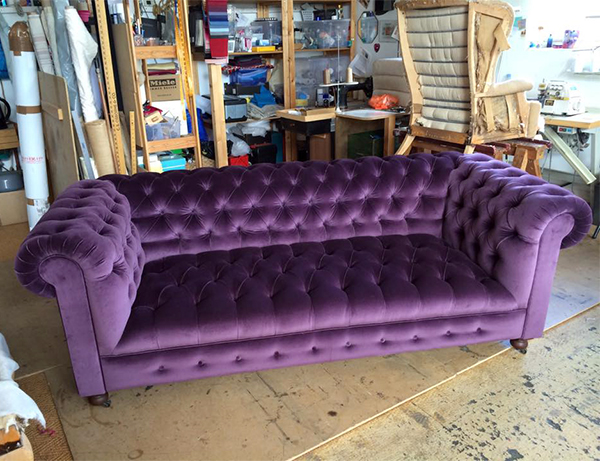 Chesterfield sofa reupholstered in purple fabric by The Upholstery House London